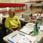Ann, a volunteer at the shelter, handles check-in for the pet shelter
