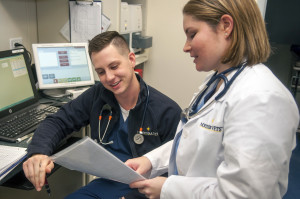 Veterinary team members consulting about a patient